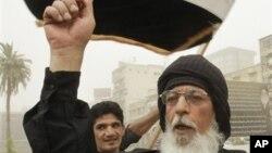 지난 6월 이라크 바그다드에서 테러범들의 처형을 요구하면 벌어진 친정부 시위.