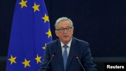 FILE - European Commission President Jean-Claude Juncker addresses the European Parliament during a debate on The State of the European Union in Strasbourg, France, Sept. 14, 2016.