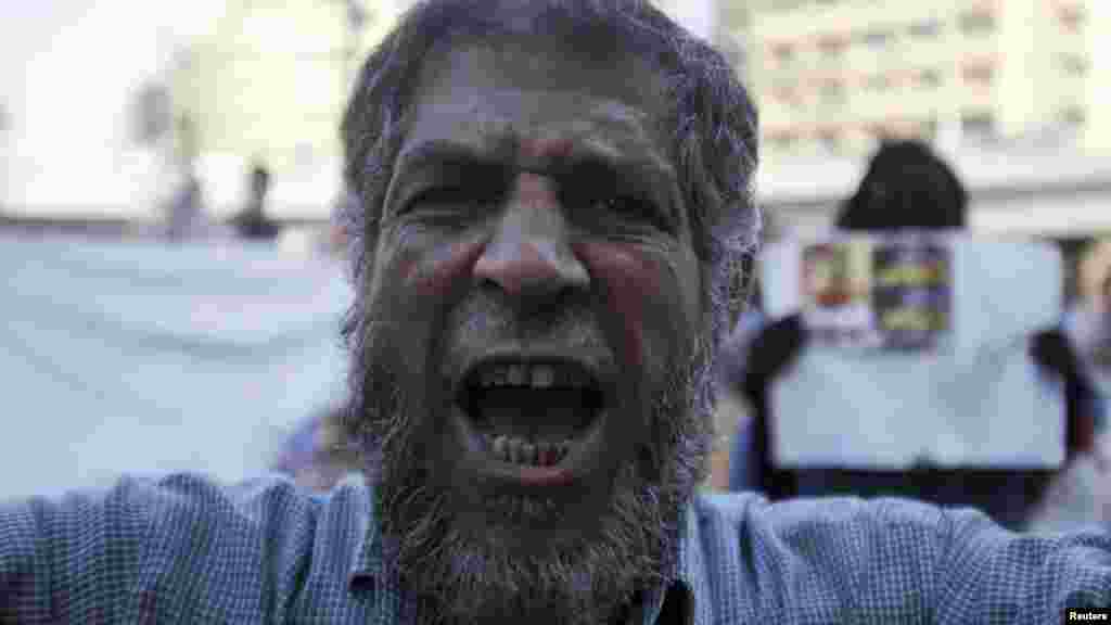 A supporter of the Muslim Brotherhood and ousted Egyptian President Mursi shouts slogans against the military, August 18, 2013.