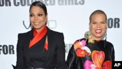 """FILE - Actress Janet Jackson, left, and author Ntozake Shange attend a special screening of """"For Colored Girls"""" at the Ziegfeld Theatre in New York. Playwright, poet and author Ntozake Shange, whose most acclaimed theater piece is the 1975 Tony Award-nominated play """"For Colored Girls Who Have Considered Suicide/When the Rainbow is Enuf,"""" has died Saturday, according to her daughter, Savannah Shange. She was 70."""