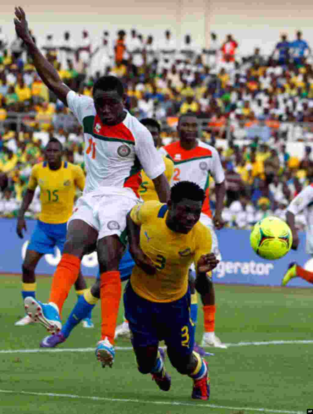 Gabon's Edmond is challenged by Niger's Issoufou during their African Cup of Nations soccer match in Libreville