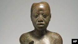 Seated figure, Tada, Ife. Copper, early 14th century