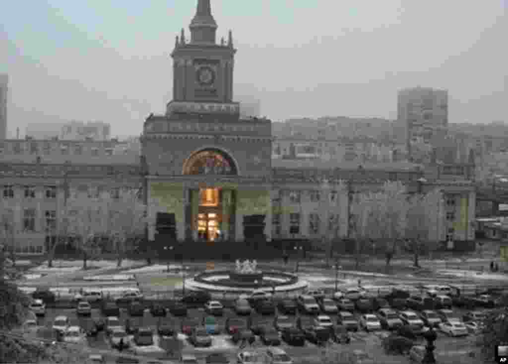 The flash of an explosion illuminates the entrance to the railway station, Volgograd, Dec. 29, 2013.