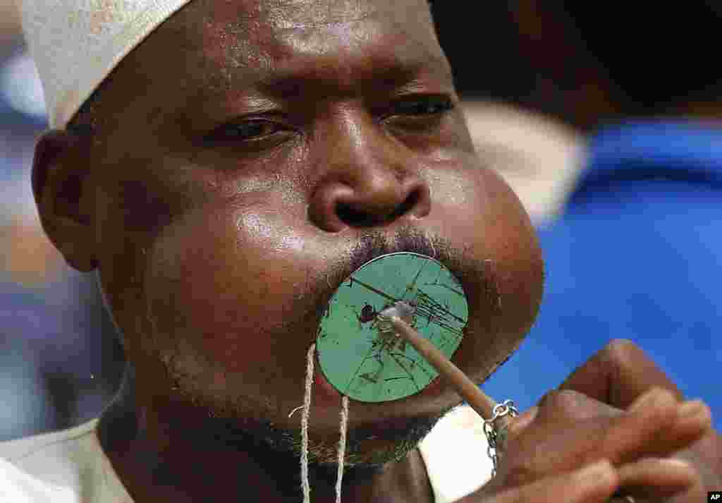 A Sudanese supporter of Gen. Mohammed Hamdan Dagalo, the deputy head of the military council, better known as Hemedti, blows a horn during a military-backed rally, in Mayo district, south of Khartoum, June 29, 2019.