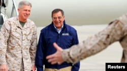 FILE - Lt. General Thomas Waldhauser, left, of 1st Marine Expeditionary Force greets then-U.S. Secretary of Defense Leon Panetta upon his arrival at Camp Pendleton, California, March 30, 2012. Waldhauser is President Barack Obama's nominee to lead the U.S. mi