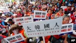 南韓民眾2019年8月13日在首爾集會抗議日本對韓的出口貿易政策。
