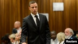 FILE - South African Olympic and Paralympic track star Oscar Pistorius attended his sentencing at the North Gauteng High Court in Pretoria, October 21, 2014.