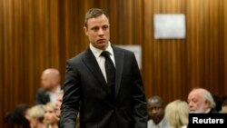 FILE - South African Olympic and Paralympic track star Oscar Pistorius attends his sentencing at the North Gauteng High Court in Pretoria, October 21, 2014.