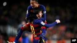 FC Barcelona's Lionel Messi, celebrates after scoring against Espanyol with teammate Neymar during a Copa del Rey soccer match at the Camp Nou stadium in Barcelona, Spain, Jan. 6, 2016.