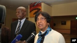 United Nations High Commissioner for Human Rights Navi Pillay,right, is flanked by Zimbabwe's Justice Minister while addressing journalists upon her arrival in Harare, Sunday, May, 20, 2012.