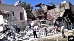 23일 폭격으로 무너진 다마스쿠스의 건물들.