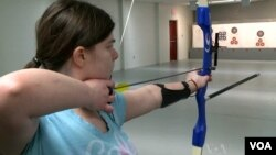 A young archer in training