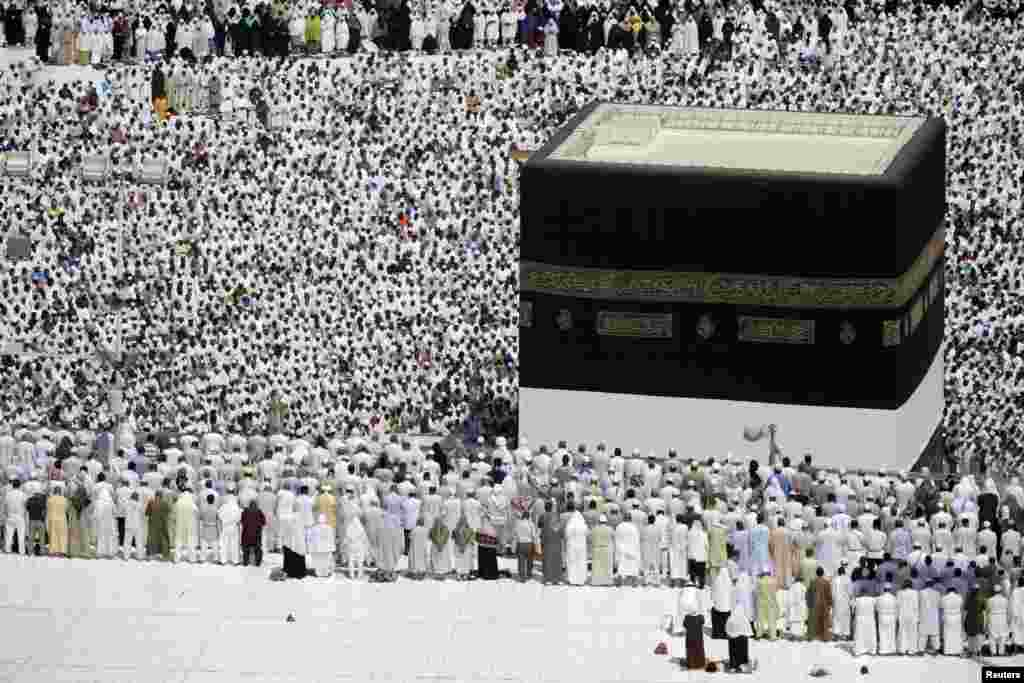 Muslim pilgrims attend Friday prayers at the Grand Mosque during the annual haj pilgrimage in the holy city of Mecca October 19