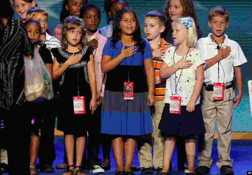 A group of third grade students rehearse saying the Pledge of Allegiance ahead of the first day of the convention in Time Warner Cable Arena, September 4, 2012.