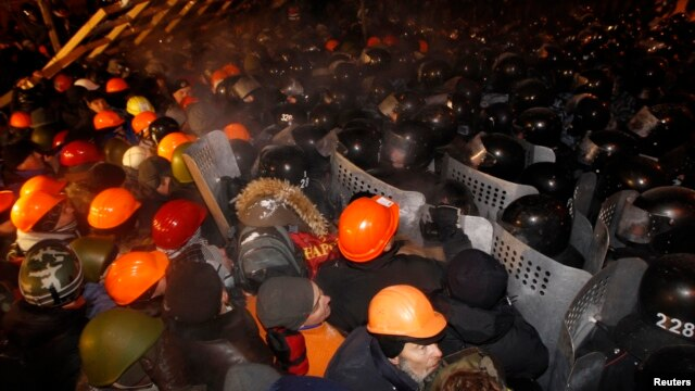 Pro-European integration protesters confront riot police at Independence Square in Kyiv, Ukraine, Dec. 11, 2013.