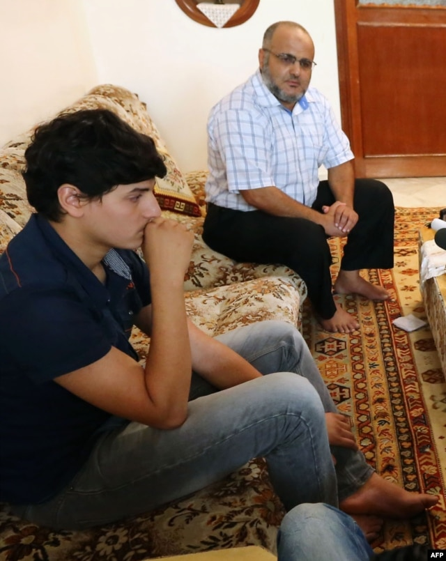Abdul Moheman al-Raghie (L), and Nabih al-Raghie, the son and brother respectively, of al-Qaida suspect Abu Anas al-Libi speak to the press in Nofleine, five kilometres from the Libyan capital Tripoli, Oct. 6, 2013.