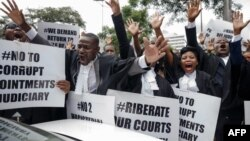 "FILE: Lawyers of the Law Society of Zimbabwe bar association take part in a ""March for Justice"" toward the Constitutional Court in Harare on January 29, 2019, to call for restoration of the rule of law, respect of human rights as well as the country's Constitution. (Photo by Jeke"