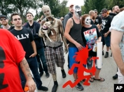 "Juggalos, as supporters of the rap group Insane Clown Posse are known, gather in front of the Lincoln Memorial in Washington during a rally, Sept. 16, 2017, to protest and demand that the FBI rescind its classification of the juggalos as ""loosely organize"