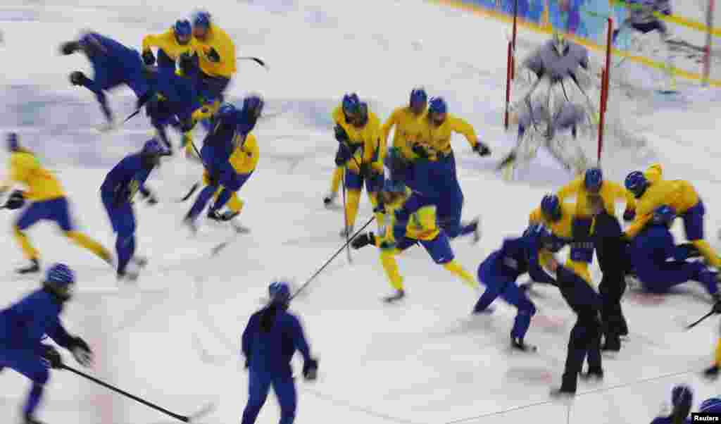Players from the Swedish women's national ice hockey team take part in a training session at the Shayba Arena in preparation for the 2014 Sochi Winter Olympics, Feb. 4, 2014.