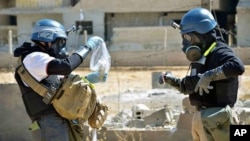 Mideast Syria Chemical Weapons News Guide