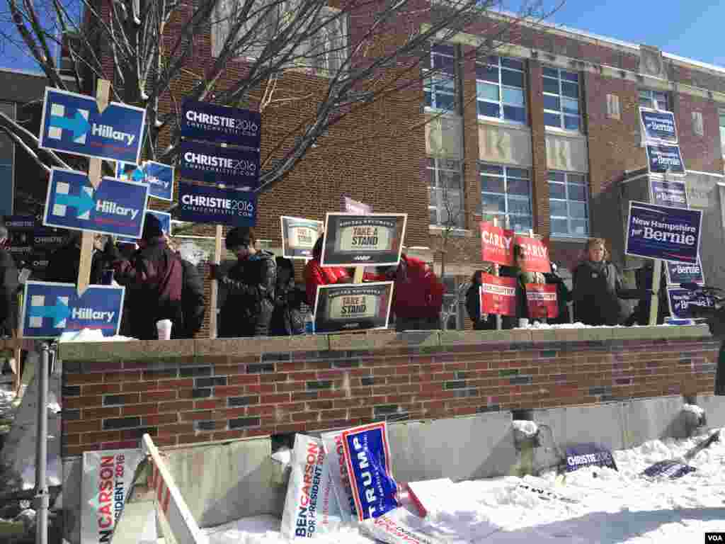Candidates' posters on display in front of a polling station in Ward 1, Manchester, New Hampshire, Feb. 9, 2016. (Photo: K. Gypson / VOA)