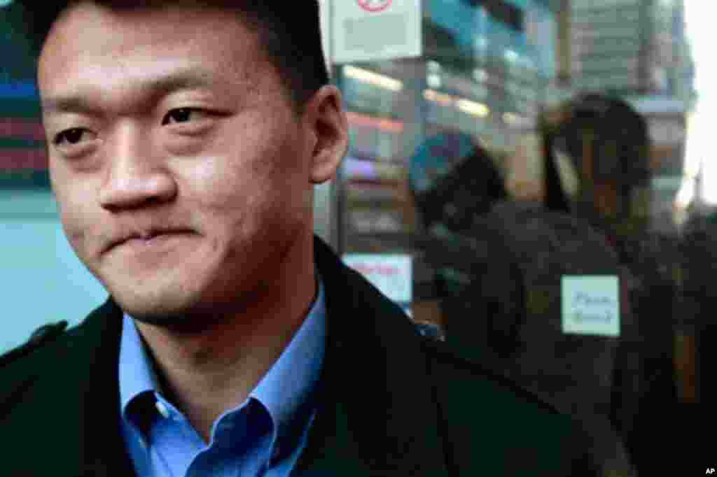 Dan Choi, an Iraq War veteran and a West Point graduate who was discharged from the military in July because he announced publicly that he is gay, reacts as he waits to enter the U.S. Armed Forces Recruiting Center in Times Square, hoping to re-enlist on