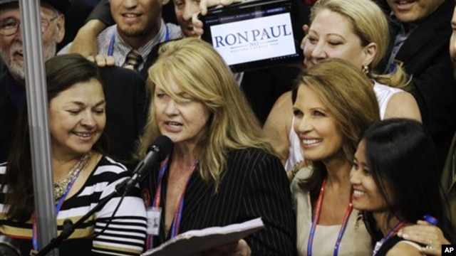 Minnesota Representative Michele Bachmann, second right, listens as Minnesota delegates casts their vote for Romney during Republican Convention, Aug. 28, 2012