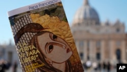"Pope Francis book on ""Fake News"", is pictured in front of St. Peter's Basilica, in Rome, Jan. 24, 2018."