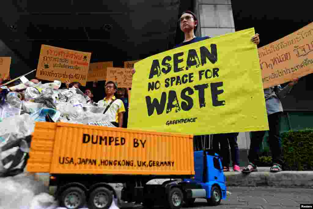 Greenpeace activists protest in front of the Foreign Ministry ahead of the 34th ASEAN meeting in Bangkok, Thailand.