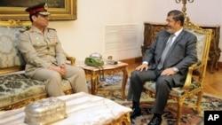 Абдель-Фаттах Сисси и Мохаммед Мурси