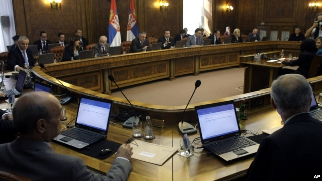 Members of the Serbian government attend a session in Belgrade, Serbia, April 22, 2013.