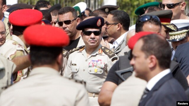 Egypt's military chief, General Abdel Fatah al-Sissi (C), is seen in Cairo's Nasr City district in this September 20, 2013, file photo.