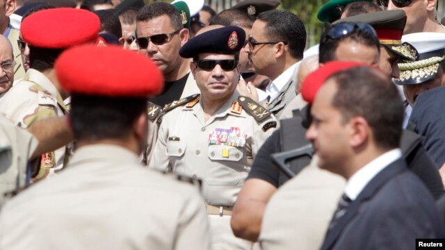 Egyptian Army Chief, General Abdel Fattah el-Sissi (C), is seen in Cairo's Nasr City district in this September 20, 2013, file photo.