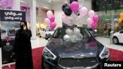 A Saudi woman is seen at the first automotive showroom solely dedicated for women in Jeddah, Saudi Arabia Jan. 11, 2018. (REUTERS/Reem Baeshen)