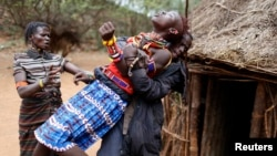A girl tries to escape as she is forced to get married in the town of Marigat in Baringo County December 7, 2014. (REUTERS/Siegfried Modola)