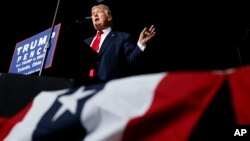 FILE - Donald Trump speaks during a rally in Toledo, Ohio, while campaigning for the 2016 Republican presidential nomination, Oct. 27, 2016.