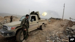 Kurdish Peshmerga fighters fire at Islamic State group positions in January. A U.S. Senator is now saying American ground troops should be used against the group. (AP Photo/Bram Janssen)