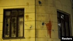 Windows of Turkish embassy smashed in reaction to downing of Russian war plane, Moscow, Nov. 25, 2015.