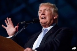 """FILE - Then-Republican presidential candidate Donald Trump speaks in Denver, July 29, 2016. Trump has questioned the utility of daily intelligence meetings, telling Fox News that Vice President-elect Mike Pence and """"my generals"""" are receiving the briefings."""