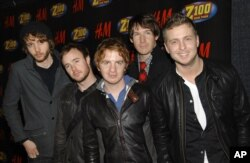 FILE - OneRepublic poses backstage at Z100's Jingle Ball