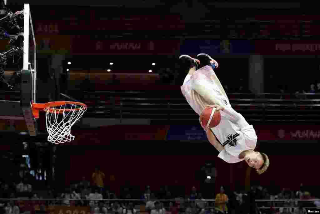 A dunk artist performs during halftime at the FIBA World Cup basketball match between South Korea and Nigeria in Wuhan, China.