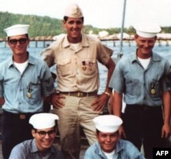 John Kerry poses with crewmates during the Vietnam War