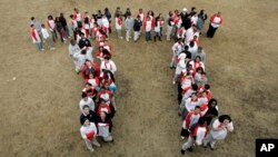 """Students gather to form the """"Pi"""" symbol, a Greek letter."""