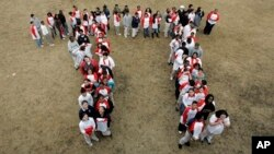 "Students gather to form the ""Pi"" symbol, a Greek letter."