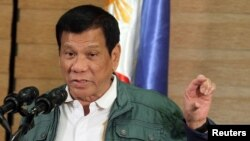 FILE - Philippine President Rodrigo Duterte speaks during a news conference in Davao.