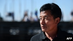 FILE - Chinese skipper Guo Chuan is pictured in La Trinité-sur-Mer, western France, Aug. 8, 2015. He is now missing in the Pacific Ocean.