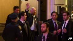 "Vice President-elect Mike Pence (top center) leaves the Richard Rodgers Theatre after a performance of ""Hamilton"" in New York, Nov. 18, 2016."