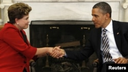U.S. President Barack Obama shakes hands with Brazil President Dilma Rousseff in the Oval Office of the White House in Washington April 9, 2012.