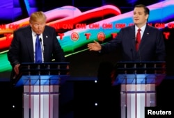 Republican U.S. presidential candidates Donald Trump (L) and Ted Cruz speak simultaneously as they discuss an issue during the debate sponsored by CNN for the 2016 Republican U.S. presidential candidates in Houston, Texas, Feb. 25, 2016.