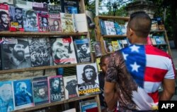 A Cuban man wearing a T-shirt with the U.S. flag walks along a street in Havana, Jan. 16, 2015.